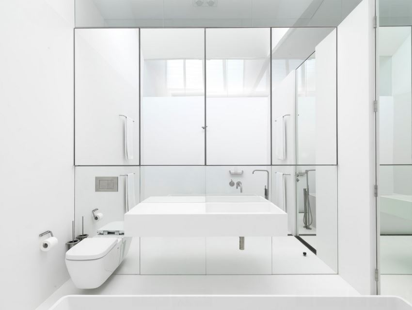 White bathroom with gleaming mirrors