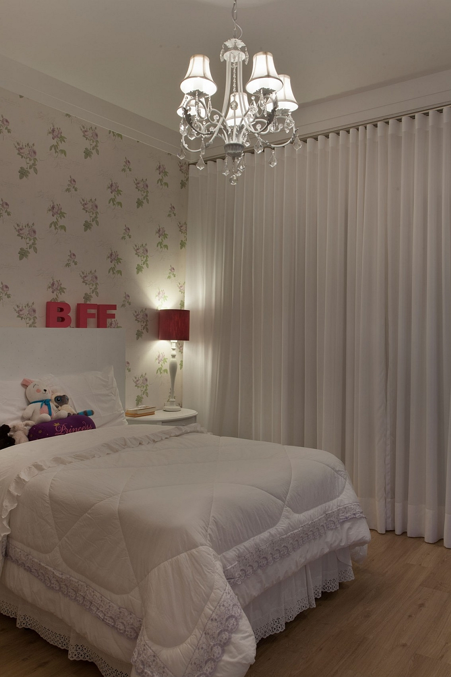White drapes give the bedroom a soft appeal