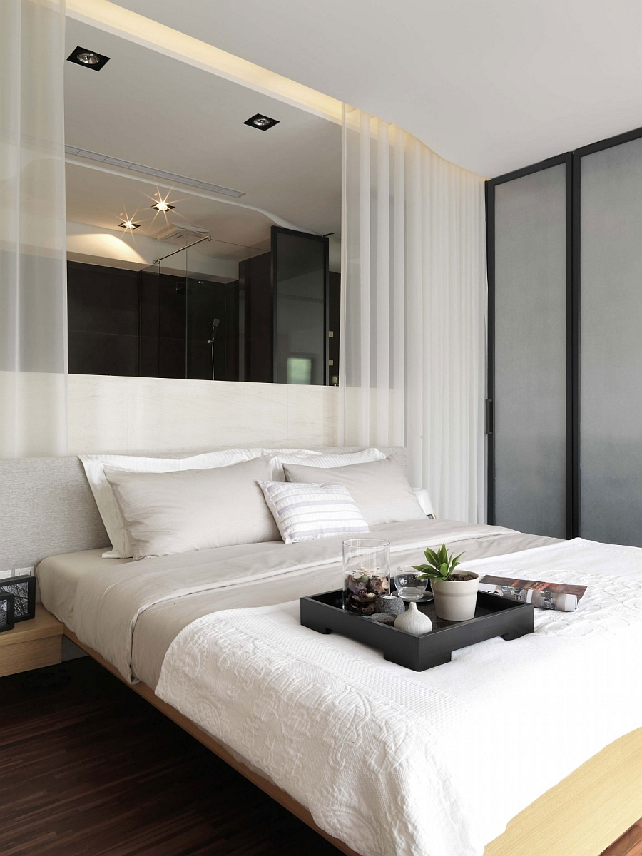White sheer curtains bring textural contrast to the bedroom