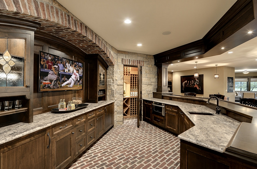 Wonderful use of space in the unique home bar creates the perfect man cave! [Design: Eskuche Design]