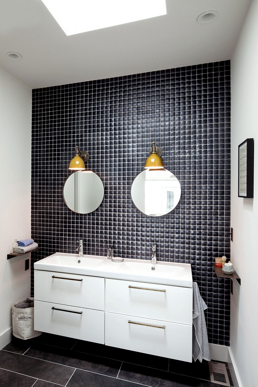 Yellow lighting fixtures bring color into the bathroom