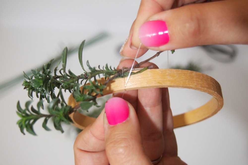 attaching the herb to the wreath form