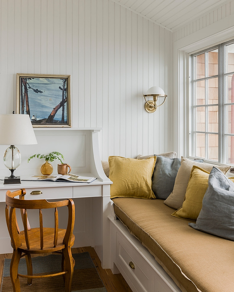 A relaxing window seat adds to the ambiance of the small home office