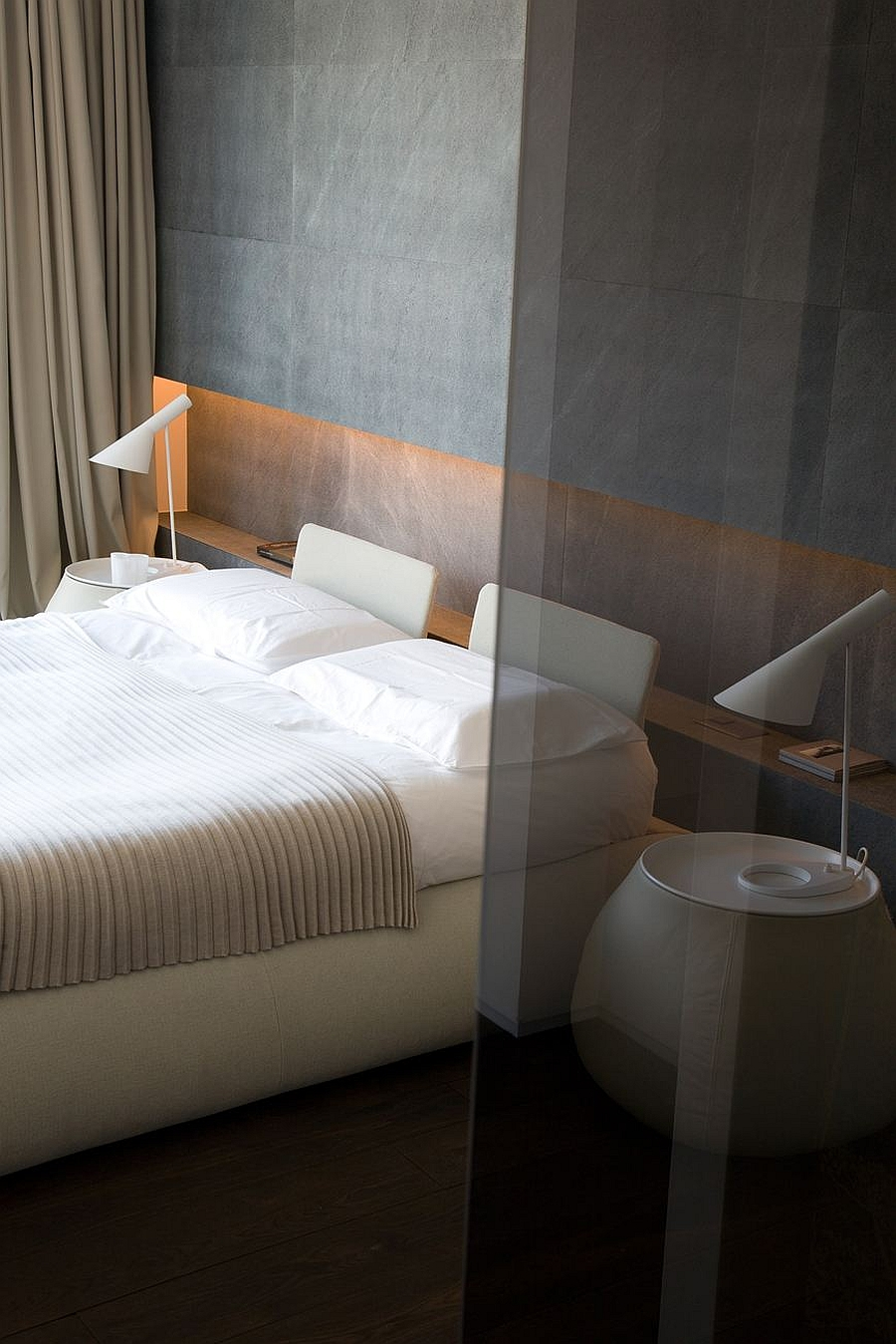 Accent wall in the contemporary bedroom with a raw concrete appeal