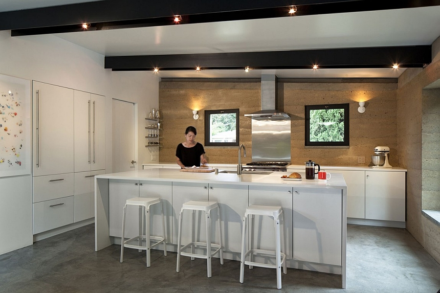 All-white kitchen island and countertop with a backdrop in earthen hue