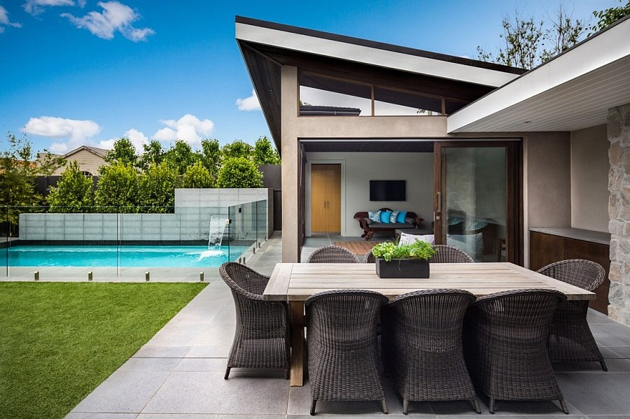 Backyard pool with water fetaure adds to the appeal of the home