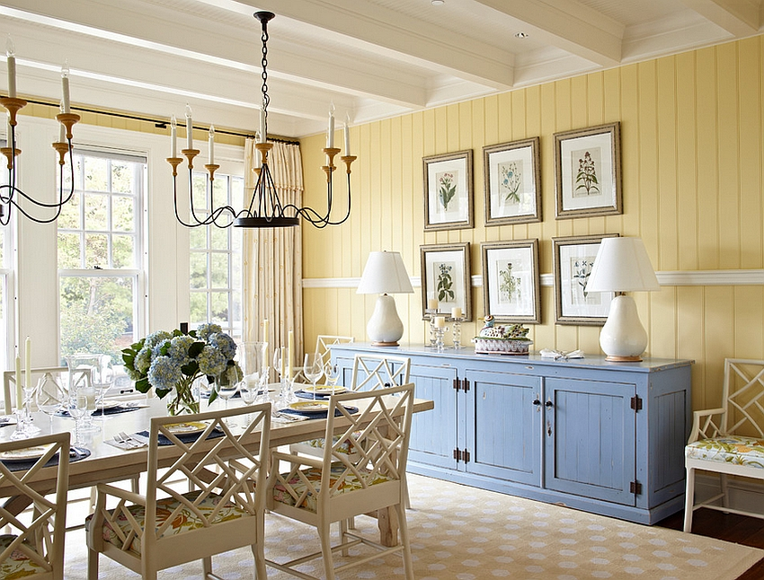 Beach style dining room in yellow with a pop of blue [Design: Tom Stringer Design Partners]