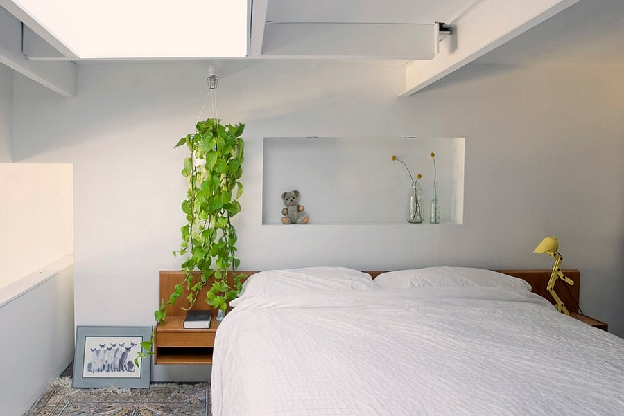 Bedroom with natural light and greenery