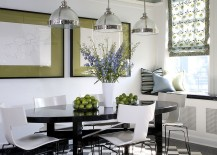 Black and white dining room with stylish pops of green