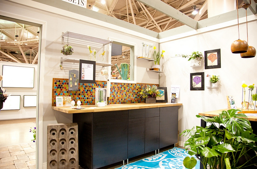 Bold multi-color penny tiles create a vivacious backdrop for the eclectic kitchen [Design: Mercury Mosaics and Tile]