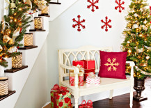 Bold snowflakes in red on the wall add to the staircase decorations 217x155 23 Gorgeous Christmas Staircase Decorating Ideas
