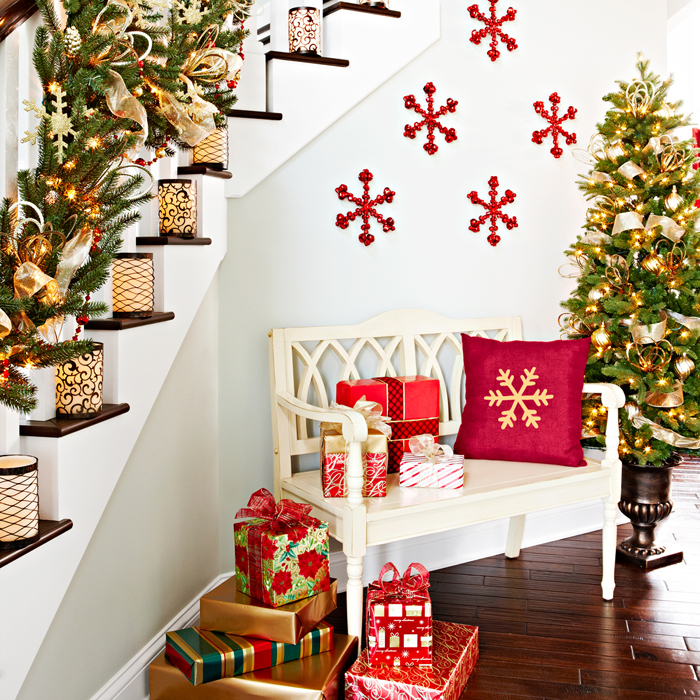 Bold snowflakes in red on the wall add to the staircase decorations [From: Lowe's creative ideas]
