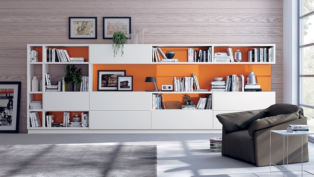 Brilliant splashes of orange enliven the neutral living room