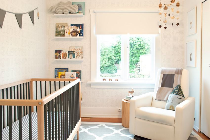 Caravan crib in a modern nursery
