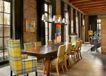 Chairs add a touch of yellow to the industrial dining room