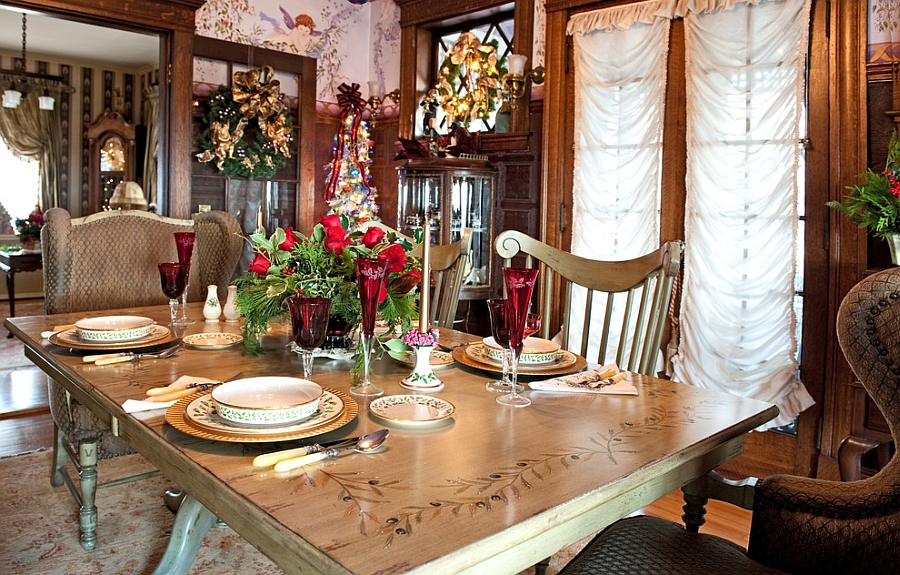 Cleverly placed holiday wreaths add to the appeal of the dining room [From: Mary Prince Photography]