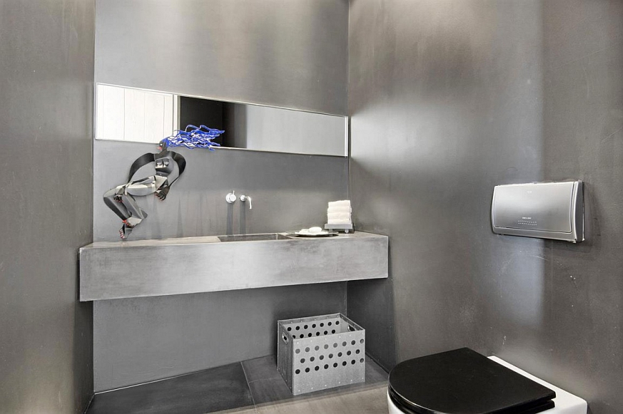 Concrete walls and vanity for the minimalist bathroom
