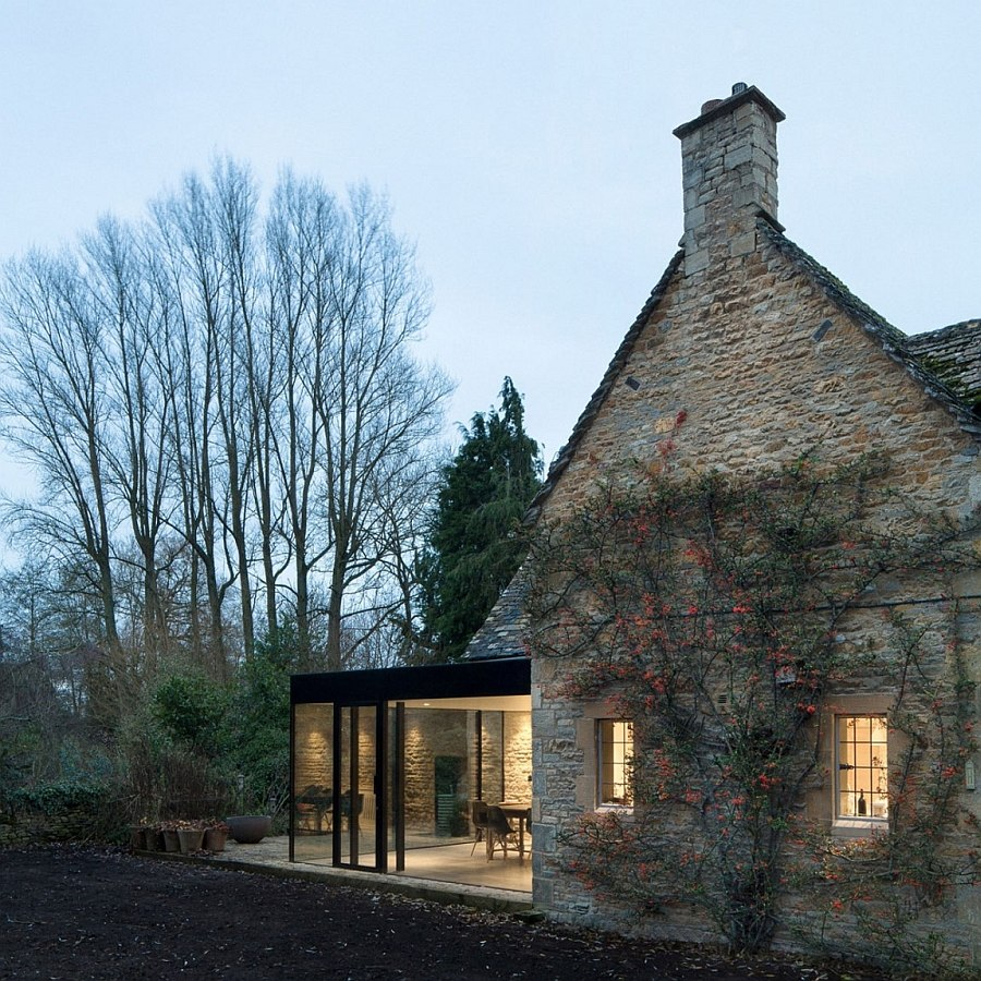 Contemporary extension of the cottage houses the dining room and kitchen 17th Century British Cottage Gets a Glassy Modern Extension