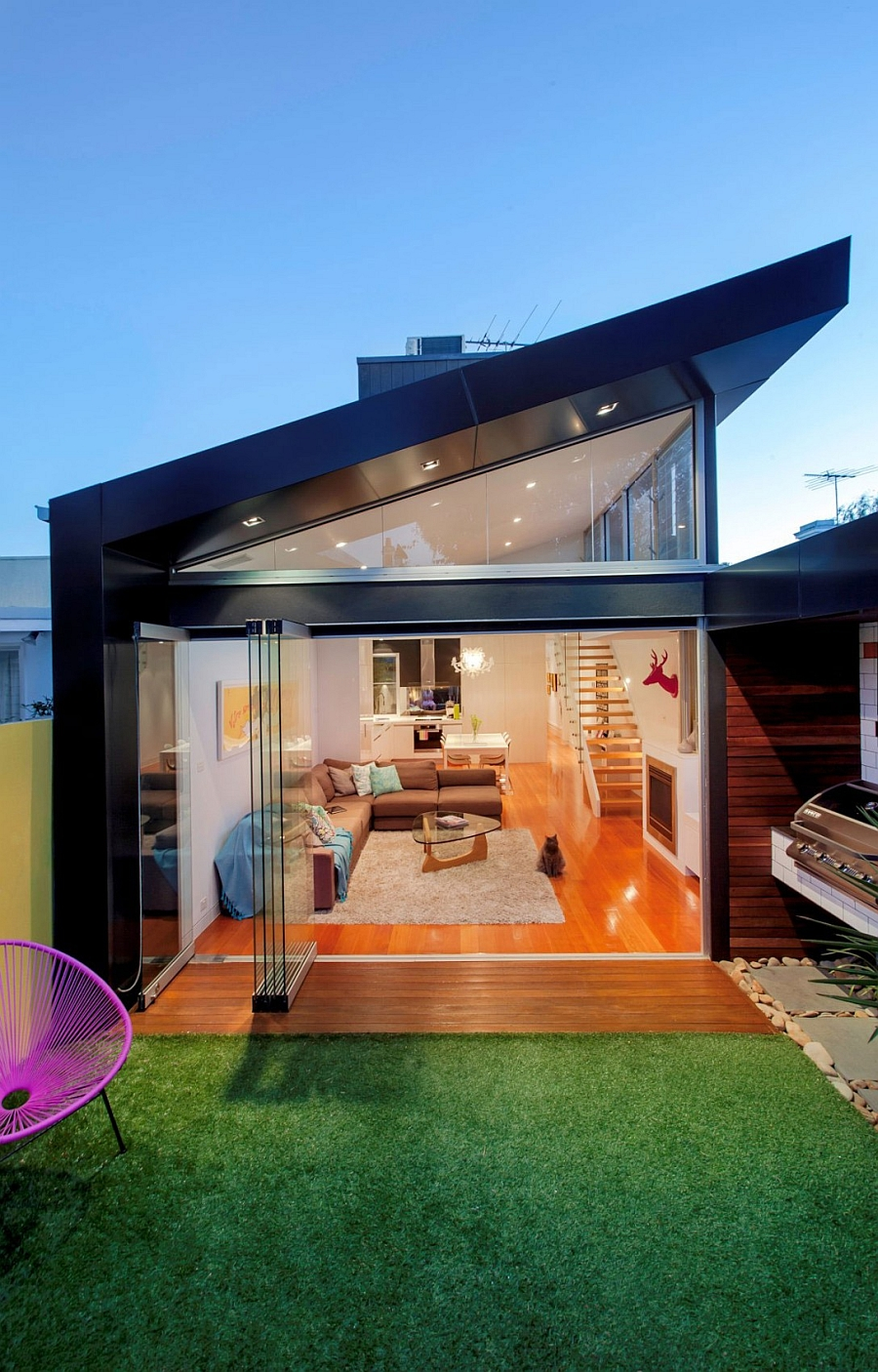 Contemporary glass extension to the traditional Aussie home