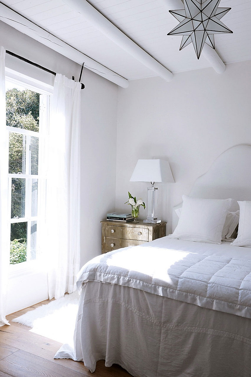 Cozy bedroom in white with ample natural ventilation
