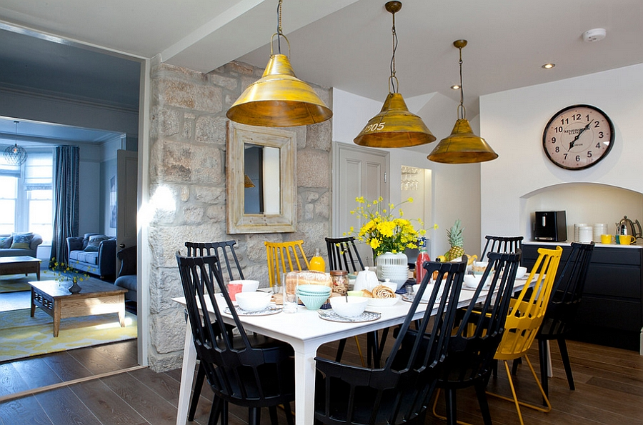 Creative blend of black and yellow in the dining! [Design: Camellia Interiors]