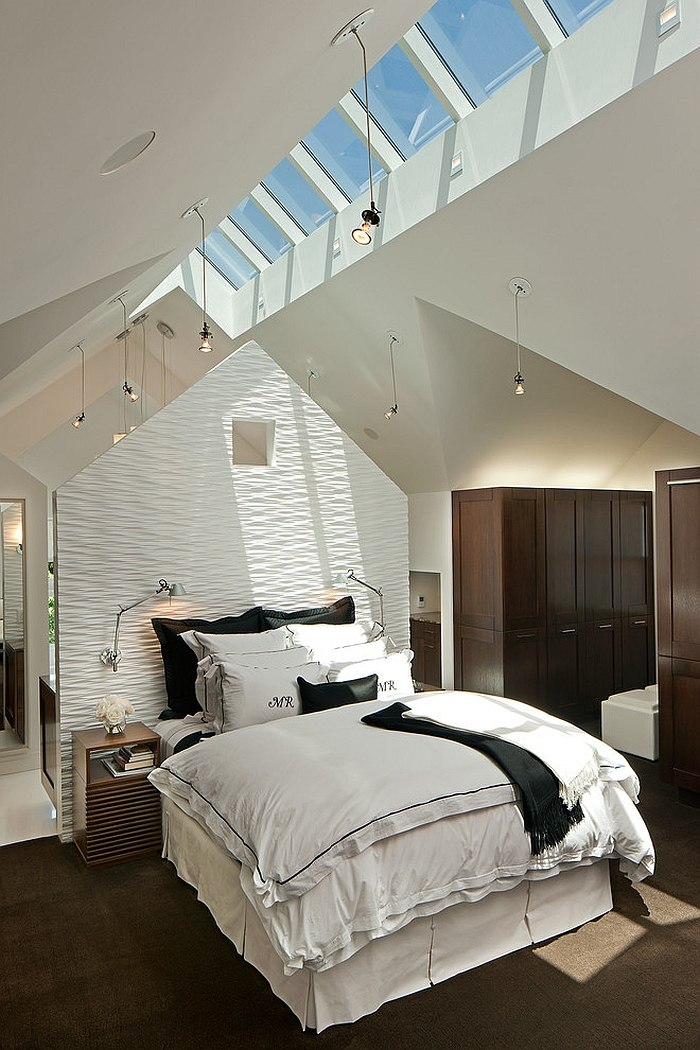 Creative ceiling with skylights enlivens the bedroom