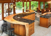 Custom crafted kitchen island turns the kitchen into a cool hangout