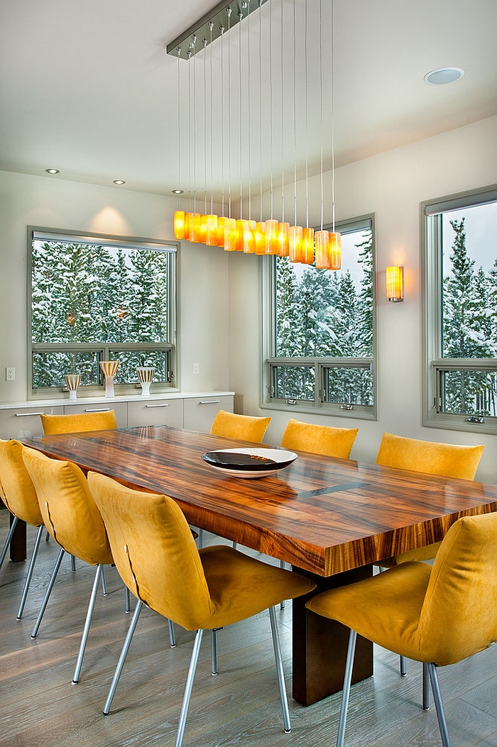 Custom designed chandelier steals the show in this contemporary dining space [Design: New Mood Design]