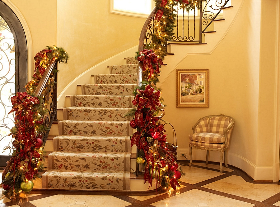 Custom holiday decorations for the staircase in gold and red [Design: Regina Gust Designs]