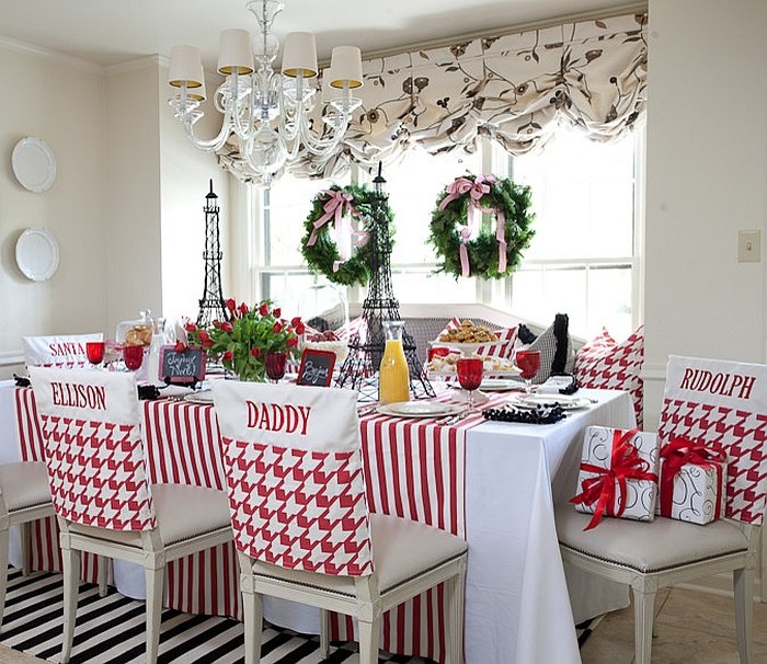 Custom made chair covers for the festive kitchen and dining space [Design: Tobi Fairley Interior Design]