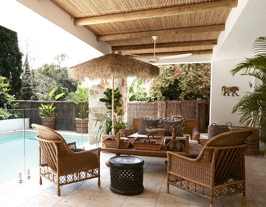 Decor in natural rattan gives the poolside deck a relaxed appeal