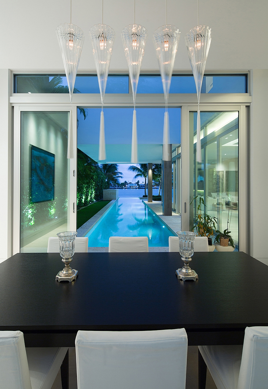 Dining space that flows into the lap pool outside