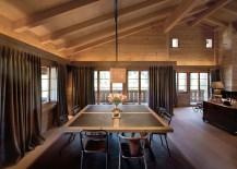 Drapes bring a touch of visual softness to the grand dining room