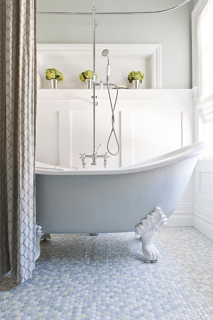 Elegant bathroom with claw-foot bathtub and mulitcolored penny tile flooring [From: Kelly Scanlon Interior Design]