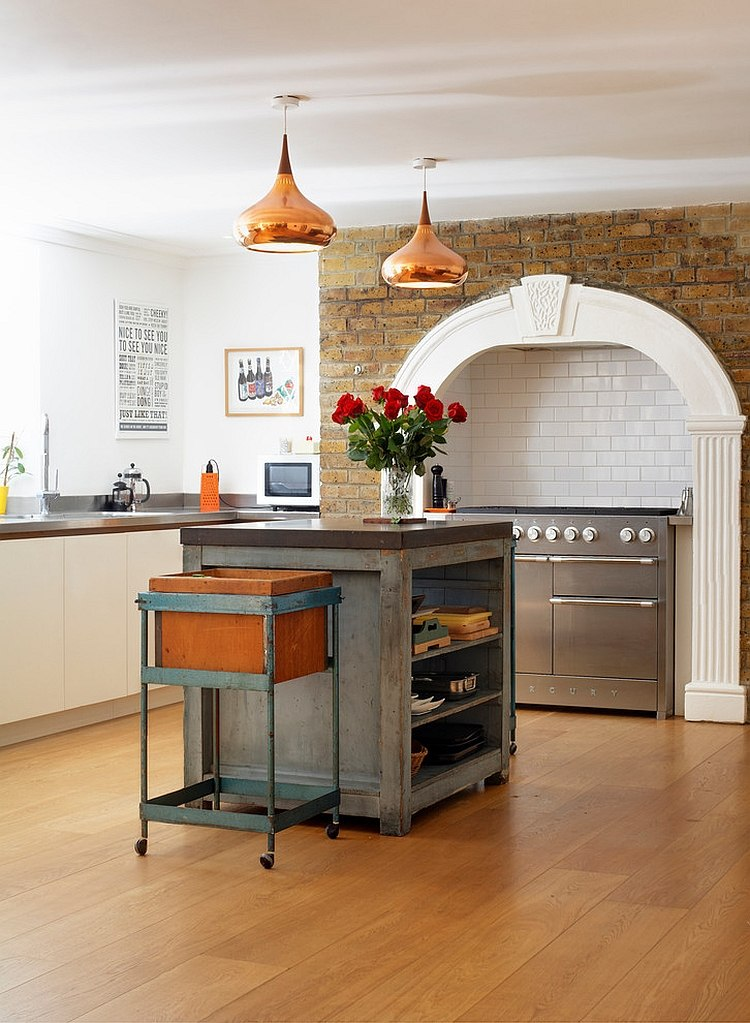 Elegant blend of eclectic and industrial styles in the kitchen [Design: Redesign London Limited]