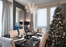 Elegant contemporary dining space with sparkling Christmas tree