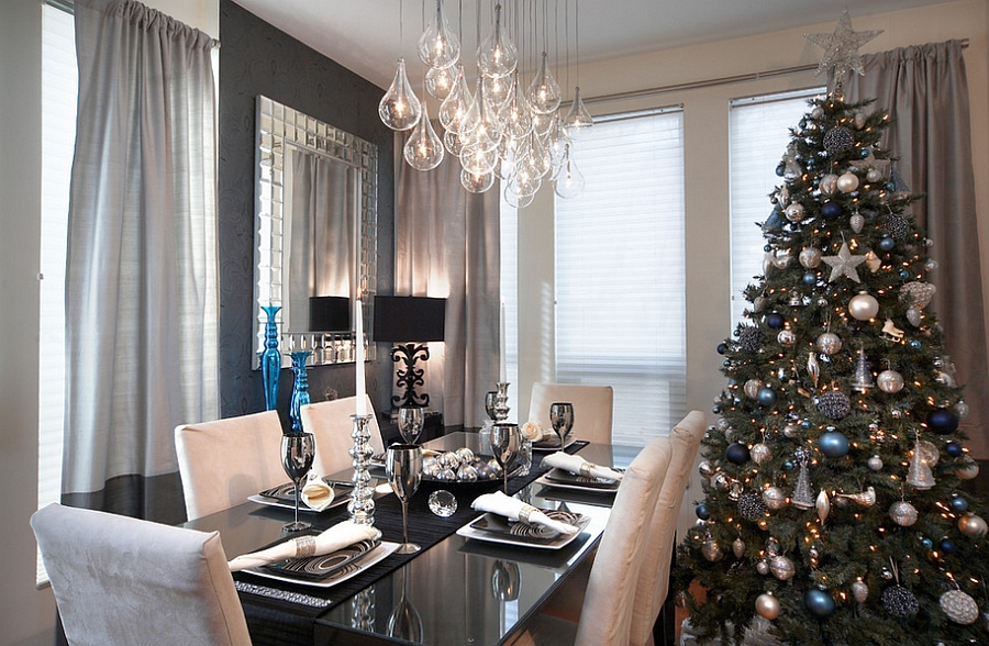 Elegant contemporary dining space with a sparkling Christmas tree [Design: LUX Design]
