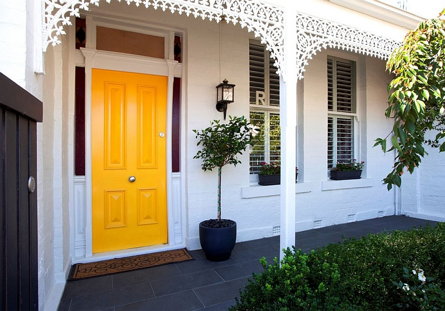 Entrance to the traditional house in Melbourne with a yellow door Traditional Victorian Home Transformed with a Glassy Modern Extension