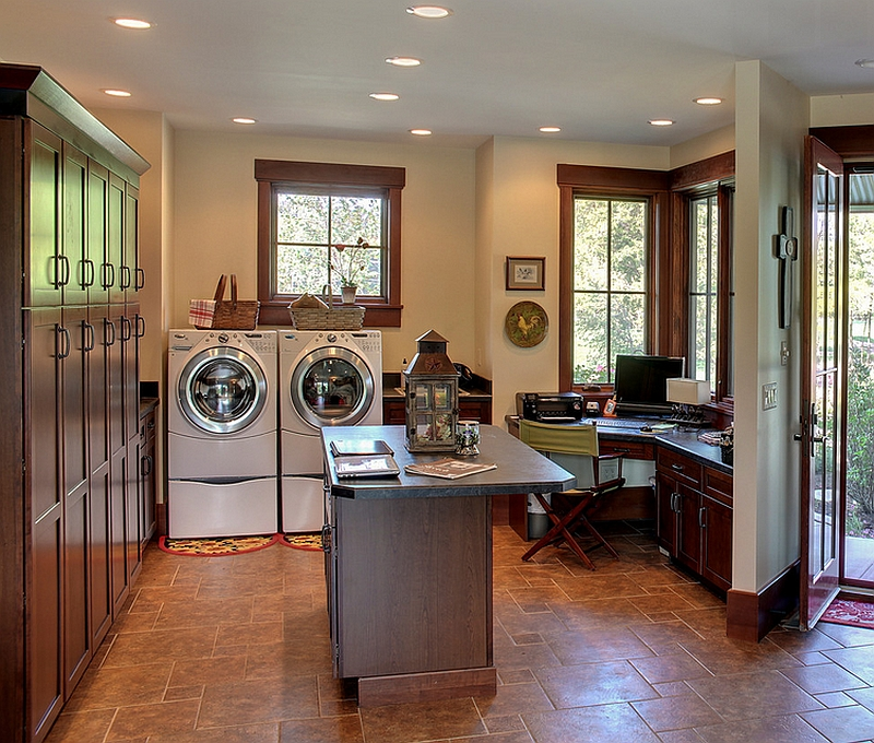 Ergonomic farmhouse style laundry with a cool workspace [Design: Helman Sechrist Architecture]