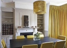 Exclusive drum pendant adds golden glint to the dining room