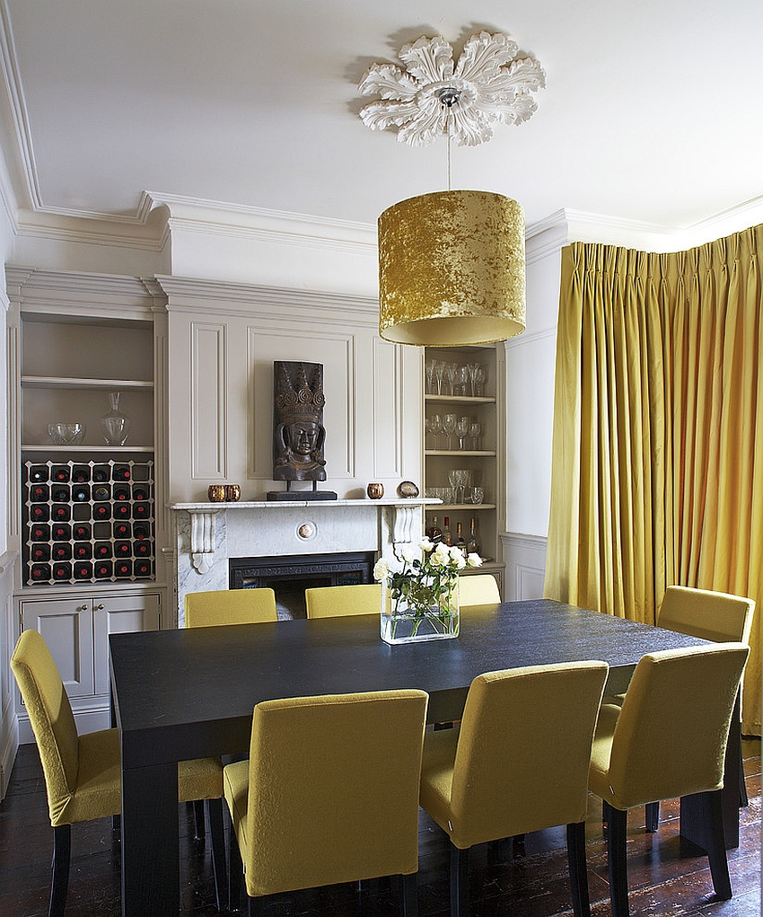 Exclusive drum pendant adds golden glint to the dining room [Design: Optimise Design]
