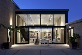Expansive glass and steel unit that opens up into the backyard patio