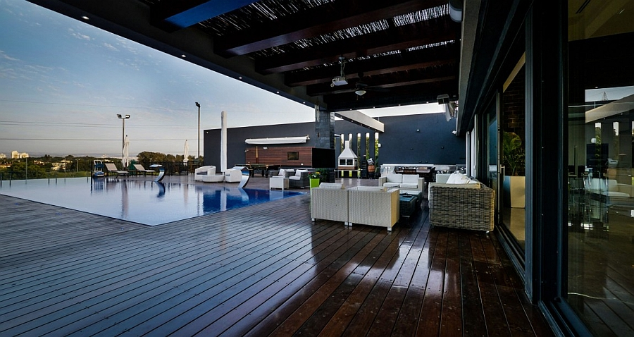 Expansive wooden deck of the luxurious penthouse with pool