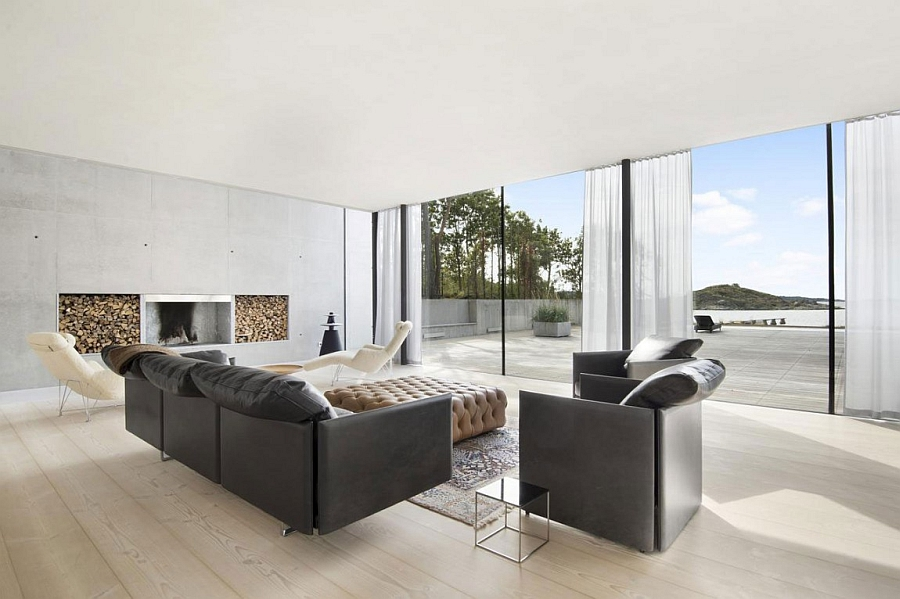 Exposed concrete walls and glass doors create a minimalist environment