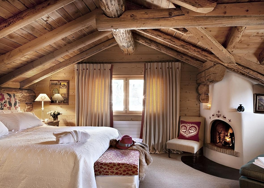 Exposed wooden beams and a rustic cabin look inside the bedroom