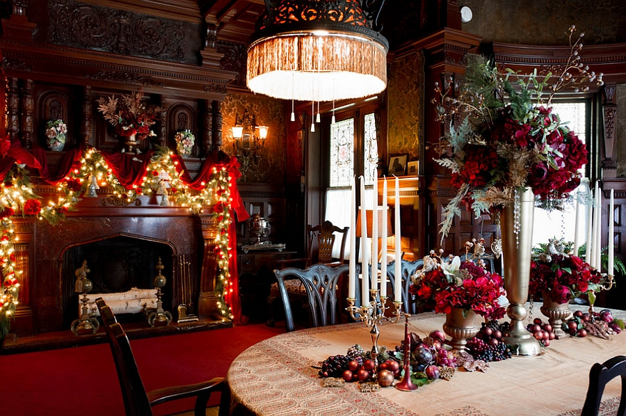 Exquisite traditional dining room draped in red and green holiday decor [Design: Rikki Snyder]