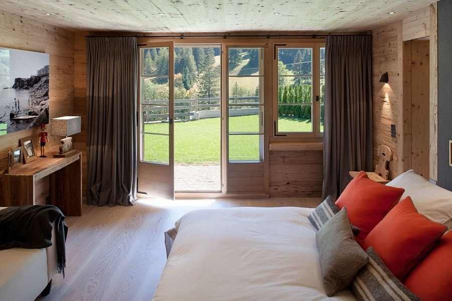 Fabulous chalet bedroom opens up towards the private backyard outside