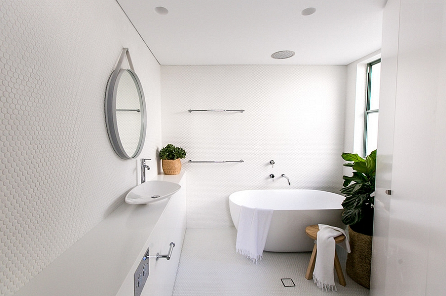 Fabulous white bathroom filled with penny tiles!
