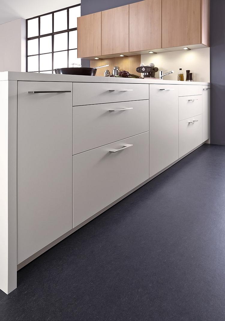 Fabulous white kitchen peninsula with a modern worktop
