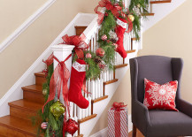 Family stockings and Christmas ornaments turn the staircase into a focal point